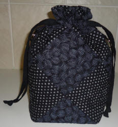 drawstring black quilted bag